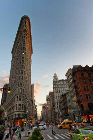 flatiron: Busy Street Scene on Fifth Avenue in front of Historic Flatiron Building at Dusk with Copy Space in Blue Sky, Manhattan, New York City, New York, USA