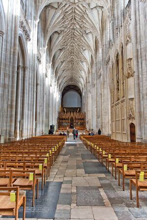 nave: WINCHESTER, UK - FEBRUARY 07: The nave looking east towards the choir inside Winchester Cathedral. February 07, 2016 in Winchester, UK