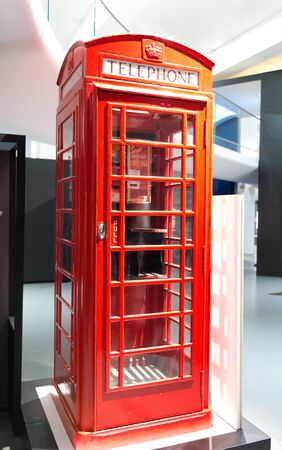 britain: Iconic empty new red British public telephone booth on display in a museum in London, UK