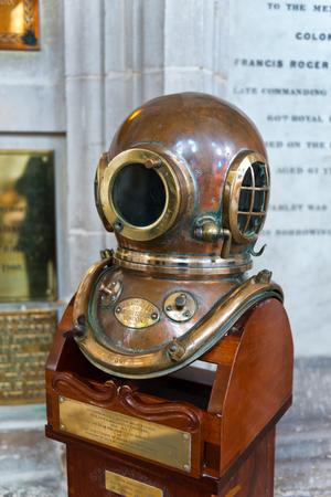 submersion: WINCHESTER, UK - FEBRUARY 07, 2016: Diving helmet of William Walker, the diver who saved Winchester Cathedral. February 07, 2016 in Winchester, UK.