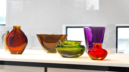 Colorful Murano glass vases on display at a manufactory on the lagoon island of Murano , Venice, Italy