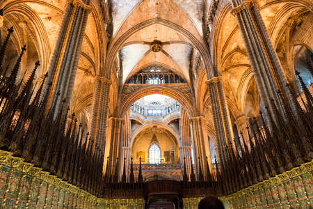 barcelona cathedral: Low Angle Interior View of Barcelona Cathedral Detailing Vaulted Ceiling and Choir Seating in Warm Lighting, Barcelona, Spain
