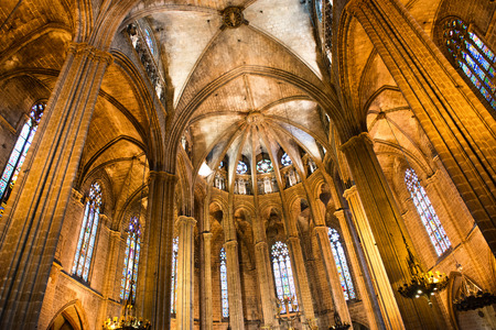 vaulted ceiling: Low Angle Architectural View of Apse, Vaulted Ceiling and Stained Glass Windows Inside Barcelona Cathedral, Barcelona, Spain Editorial