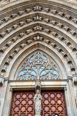 barcelona cathedral: Architectural Detail of Main Portal - Decorative Gothic Entrance of Historic Barcelona Cathedral in Barcelona, Spain
