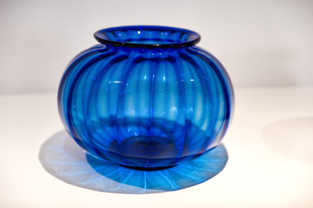 venice: Deep blue ribbed Murano glass vase with a bulbous body on display at a manufactory on the island of Murano in the Venice lagoon, Italy
