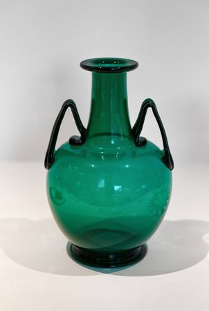 souvenir: Murano, Venice green glass vase with two angled handles from this Venetian Island famous for its history of glass manufacturing