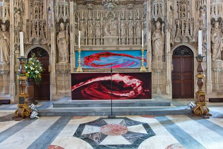 winchester: WINCHESTER, UK - FEBRUARY 07: The High Altar featuring an ornate 15th-century stone screen inside Winchester Cathedral. February 07, 2016 in Winchester, UK