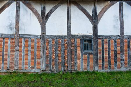 timbering: Half timbering. Half timbered house facade with ordinary brick infill left exposed