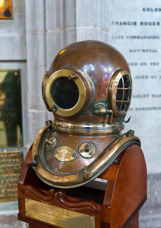 shiny suit: WINCHESTER, UK - FEBRUARY 07, 2016: Diving helmet of William Walker, the diver who saved Winchester Cathedral. February 07, 2016 in Winchester, UK.