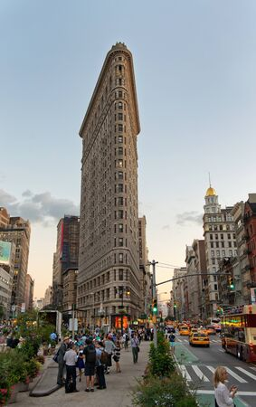 broadway tower: Bustling Pedestrians and Traffic on Fifth Avenue by Historic Flatiron Building at Dusk in Manhattan, New York City, New York, USA Editorial