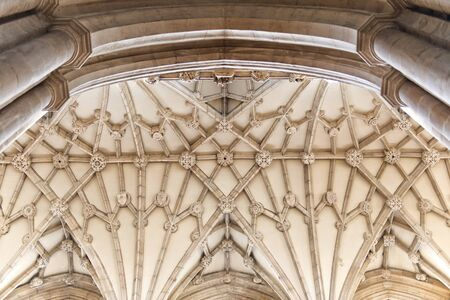 gravelly: Ceiling detail view of curves and lines converging in the architecture design of an old cathedral in the United Kingdom