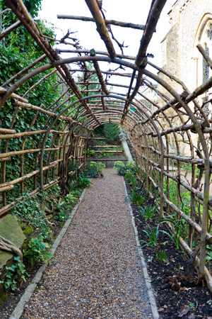 Interior View On Stone Path Of Empty Wooden Garden Trellis Outside Of The  Historic Winchester Castle