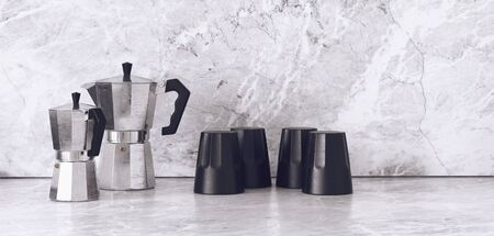 brew house: Pairs of black and chrome finish tea pots and mugs on smooth granite marble surface. 3d Rendering.