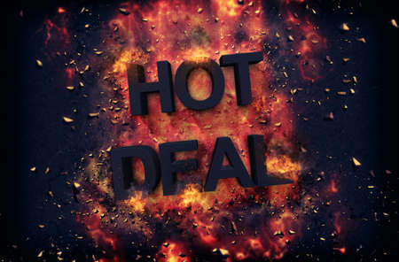 dynamic heat black: Burning orange fiery flames and explosive sparks on a dark background with the word - HOT DEAL - in black text for a dramatic poster design Stock Photo
