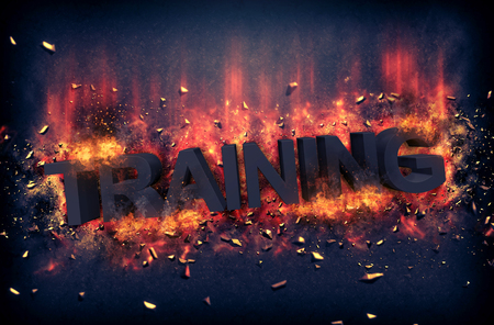 dynamic heat black: Burning orange fiery flames and explosive sparks on a dark background with the word - TRAINING - in black text for a dramatic poster design Stock Photo