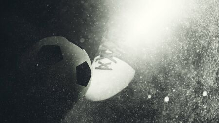 championships: Beam of light illuminating a football boot and ball with a grunge textured overlay