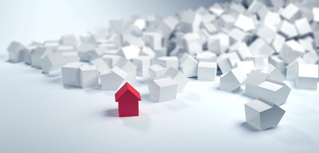 dream home: Single red house standing in the foreground in a pile of multiple white houses with copy space in a conceptual image