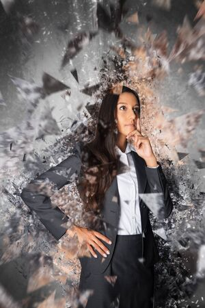 shards: Conceptual rendering of woman with explosive ideas dressed in business attire and surrounded by shards of glass