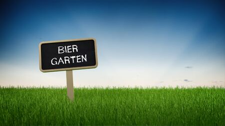 beer garden: Ground level perspective on German language beer garden sign stuck in neat green grass with clear blue sky background Stock Photo