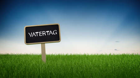 pitched: Vatertag - Father Days - handwritten German signboard pitched on a grassy green field with blue sky background and copy space in a panoramic view