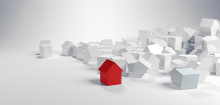 jumble: Individuality and diversity concept with a single red model house standing in the foreground of a large pile of white houses in a panoramic banner Stock Photo
