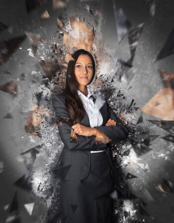 glass ceiling: Single young professional woman in business suit surrounded by powerful fractured glass ceiling exploding effect concept Stock Photo