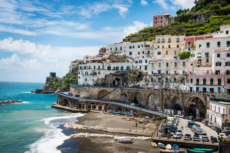 positano: Picture postcard view of the village of Atrani, Amalfi Coast, Salerno, Campania, Italy with its historic houses and protective walkway