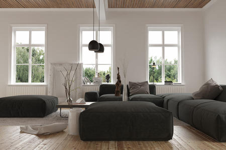 Three windows behind large black sofas in empty room at second story level with wooden floor. 3d Rendering.