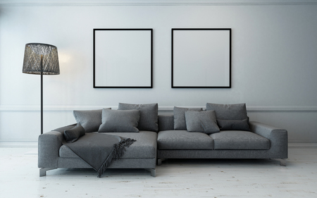 rendering: Spacious living room with grey couch and lamp beside wall with two empty square frames. 3d Rendering. Stock Photo