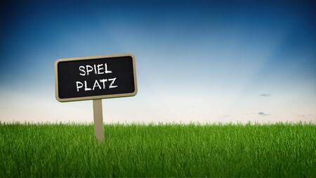 spiel: German language playground text in white chalk on blackboard sign in tall green turf grass under clear blue sky background
