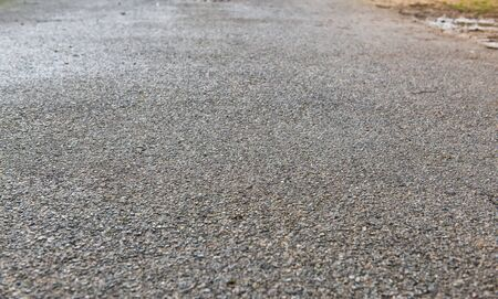 road surface: Closeup of paved road. Road stone texture with blurring effect at the background