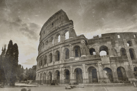 mapped: Retro tone mapped aged image of the Roman Colosseum amphitheatre in sepia tones for vintage travel and sightseeing concepts Stock Photo