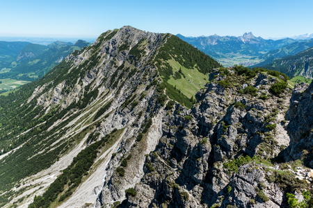 Iseler Mountain with wild rocky cliff. The Iseler is a tall mountain close to the Oberjoch Valley and the village Bad Hindeland in Bavaria, Germany Stock Photo