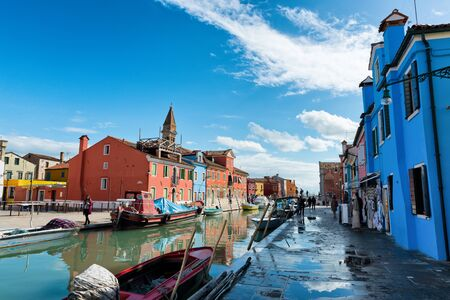 canal street: Street scene with a canal and moored boats in Burano, Italy