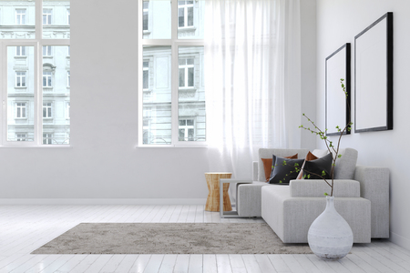 View of buildings from inside spacious white living room with throw rug, large planter and sofa underneath blank square picture frames. 3d Rendering.