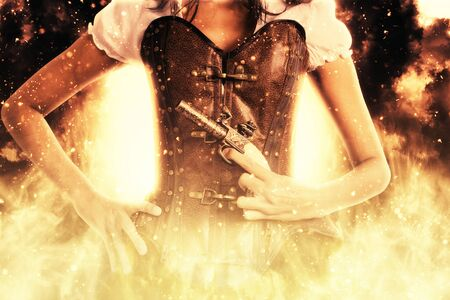 annihilation: Close up view on single woman in steampunk outfit holding pistol in front of her while surrounded by flames