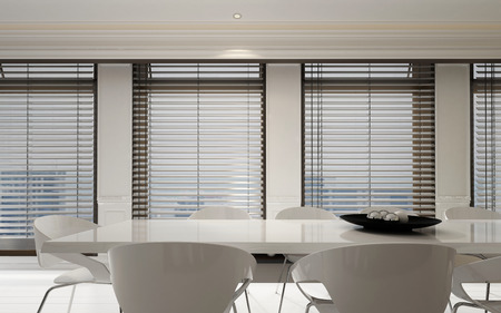 Stylish white dining room suite in a bright home interior with a row of large windows with Venetian blinds in a spacious monochromatic room, 3d rendering Archivio Fotografico