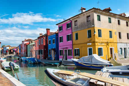 Street scene in famous Burano with its colorful houses near Venice, Italy Editorial