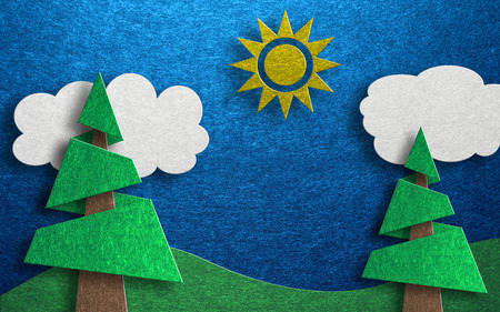 rolling hills: Collage made of two cutout conical shaped trees with rolling hills and clouds against a blue background and a single sun at its top center