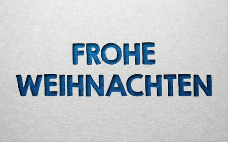 txt: Frohe Weinachten background card design wit textured blue txt on a grey background with copy space for your seasonal Christmas greeting