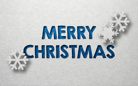 christmas blue: Merry Christmas card design with snowflakes and textured blue text on a grey background with copy space for your seasonal message
