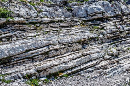 strata: Exposed weather rock strata on Grosser Daumen in the Allgau Alps Germany showing the formation of the layers