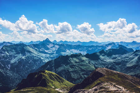 recedes: Scenic vista of white clouds over the widespread wilderness of the beautiful German Alps