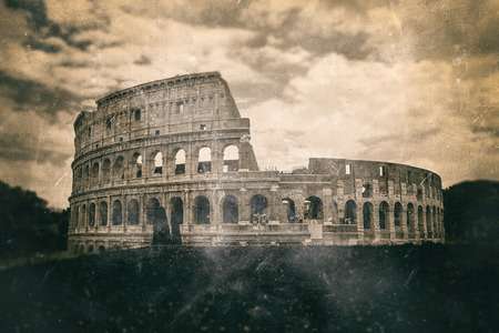 sepia toning: Vintage aged print effect of the Colosseum, Rome with sepia toning and fading under a cloudy sky in a travel concept