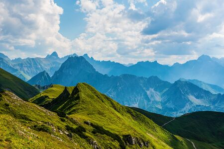 recedes: Scenic Alpine landscape in the Allgau alps in Germany with a vista of rugged peaks stretching into the distance