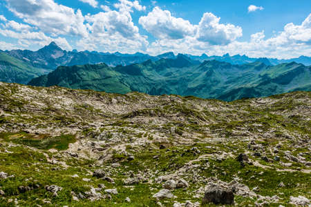 recedes: Amazing view of majestic blue mountain ranges on a beautiful spring afternoon as fluffy clouds float overhead Stock Photo