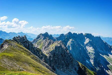 recedes: Alps Mountains for beautiful landscape background under blue sky with white clouds and copy space