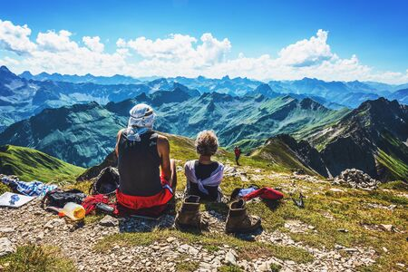 allgau: Pair of hikers resting with shoes off near summit of mountain in Allgau, Germany