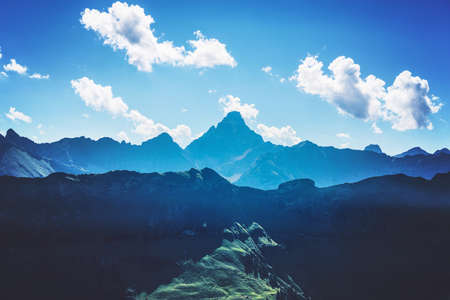 recedes: Mountains in shadows and sunlight of the Alps near Allgau Germany under blue sky