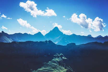 allgau: Mountains in shadows and sunlight of the Alps near Allgau Germany under blue sky